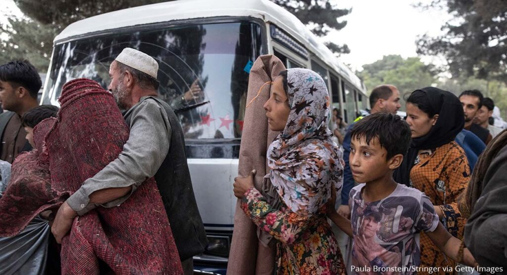 KABUL, AFGHANISTAN - AUGUST 12: Displaced Afghans from the northern provinces are evacuated from a makeshift IDP camp in Share-e-Naw park to various mosques and schools on August 12, 2021 in Kabul, Afghanistan. People displaced by the Taliban advancing are flooding into the Kabul capital to escape the Taliban takeover of their provinces. (Photo by Paula Bronstein/Getty Images)