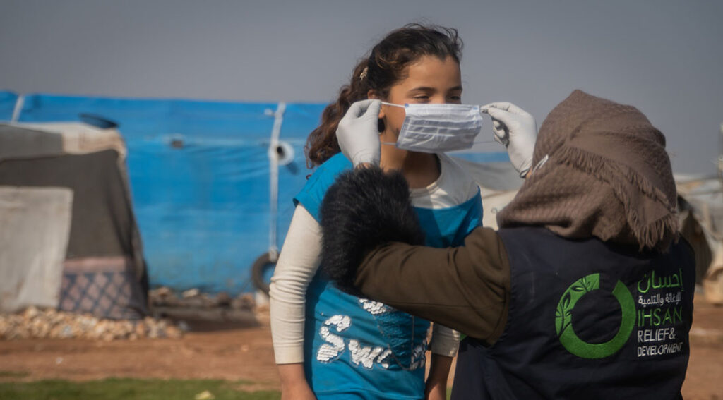 Nour (name changed for security), is a social worker at Ihsan Relief and Development, one of CARE's Syrian partner organizations in northwest Syria. She works with displaced children, living in camps, to raise awareness about COVID-19 and how to prevent it from spreading. Photo: IhsanRD/CARE