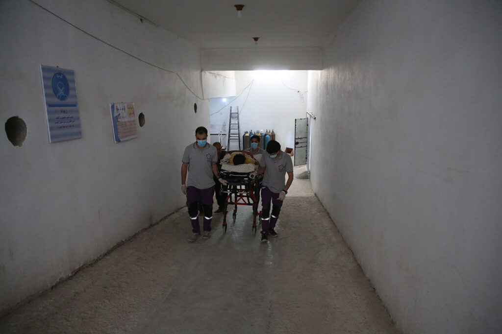 A patient is being moved from hospital to home, at AMAL Hospital in Syria.
