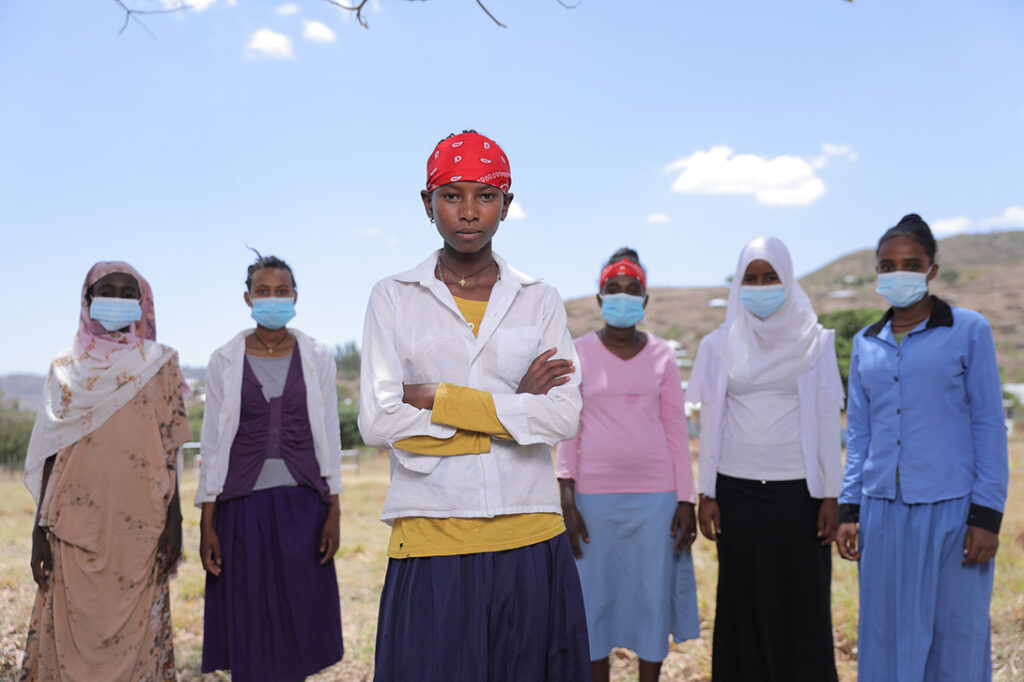A group of women standing together who are participating in CARE's Women Respond imitative in Ethiopia in 2021. Photo by Terhas Berhe /CARE