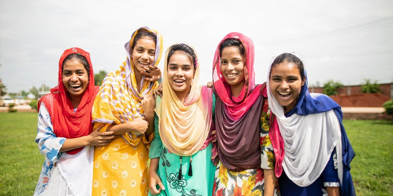 Participants, from left to right; Mst. Samsuara (red headscarf), Mohona Akter (yellow dress), Surma (green dress), Mim Ara (pink headscarf) and China Akter (dark blue dress), from The Empowering Women Workers in Bangladesh training.