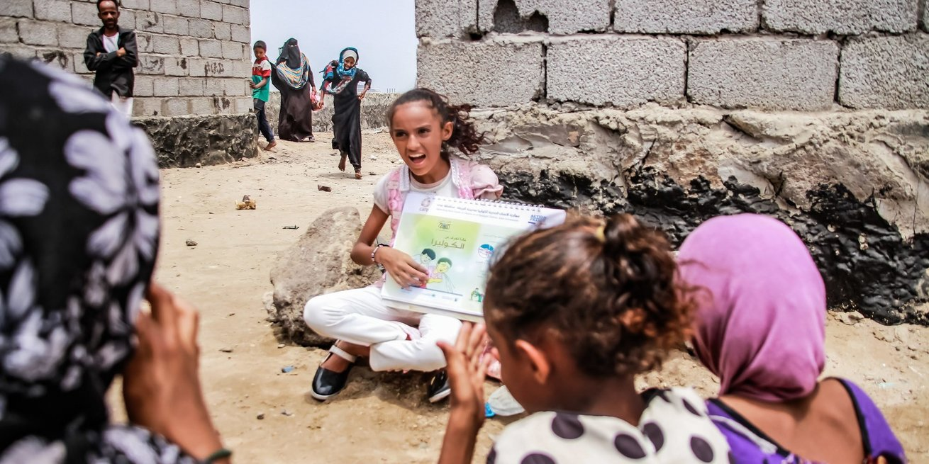 Amaal demonstrates good hygiene practices to other children in her community in the Al Buraiqah district of Aden, Yemen