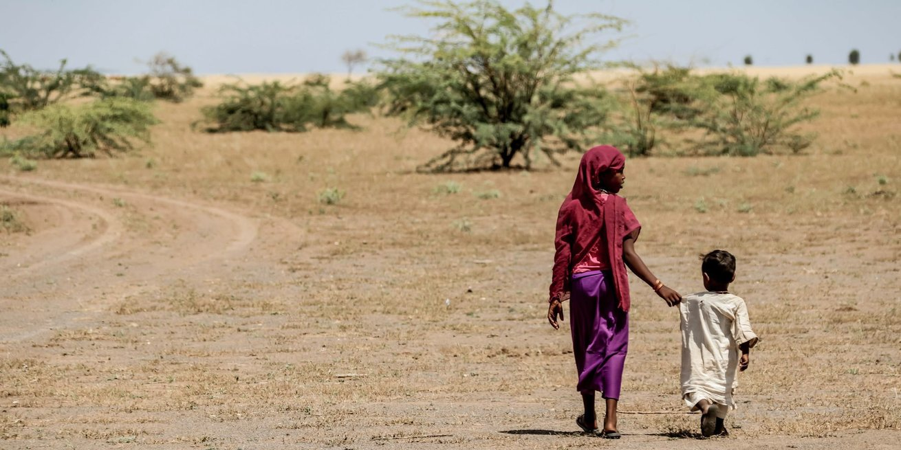 Women leaving a CARE-supported nutrition center in Eastern Sudan.. Sabine Wilke/CARE