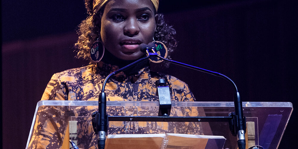 <p>Hilda Flavia Nakabuye, climate activist from Uganda, speaking at the #March4Women rally at the Southbank Centre.</p><p>&nbsp;</p><p>CARE International UK&rsquo;s annual #March4Women event to celebrate International Women&rsquo;s Day (8th March 2020) featured a rally at the Southbank Centre, London, followed by a march through central London to Parliament Square, where thousands of marchers were greeted with a grand finale of live music and powerful speeches from feminists and climate activists. The event celebrated the power and passion of women on the frontlines of the climate crisis, and marchers were asked to raise their voices for gender equality and climate justice.</p><p>&nbsp;</p><p>Equality campaigners Helen Pankhurst, Bianca Jagger, Shola Mos-Shogbamimu, Uganda&rsquo;s Hilda Flavia Nakabuye, and 15-year-old climate activist Scarlett Westbrook were among those leading the march and speaking, along with Mayor of London Sadiq Khan. Actors Natalie Dormer, Nicola Coughlan, Himesh Patel, Sanjeev Bhaskar, Camilla Thurlow, Mary Olabisi and Su McLaughlin read verbatim testimonies of people devastated by the climate crisis, arranged by playwright Tess Berry-Hart. A panel debate on the climate crisis and gender justice featured journalist Lucy Siegle, climate scientist Dr Tamsin Edwards, gender and climate expert Madara Hettiarachchi, and asylum seeker and activist Beauty Musewe. Singers Emeli Sand&eacute;, RAYE, Kaiser Chief&rsquo;s Ricky Wilson, L&aring;psley, and the Urban Voices Collective (performing with the Bond quartet) provided entertainment and inspiration. Actor George MacKay and poets Nikita Gill, Maja Antoine-Onikoyi, and Selina Nwulu inspired with their words. BBC broadcaster and journalist Emma Barnett hosted the rally and actor, broadcaster and co-founder of the UK Women&rsquo;s Equality Party, Sandi Toksvig, hosted the grand finale. Music at the Southbank Centre rally and the Parliament Square grand finale was produced by celebrated compose