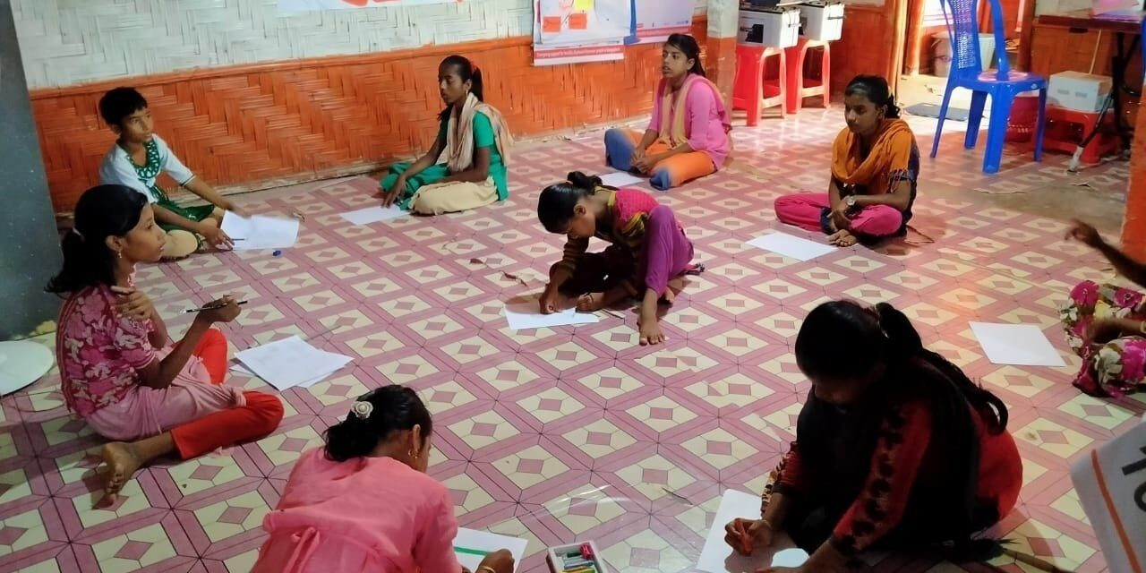 Girls participate in a drawing session at the Women and Girls' safe space in Cox's Bazar refugee camp, Bangladesh