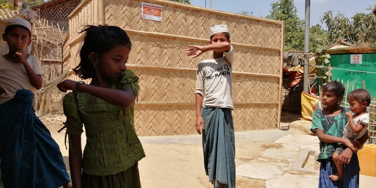 Children in Cox's Bazaar, Bangladesh, home to the world's largest refugee camp, participate in a CARE workshop on coughing and sneeze etiquette.