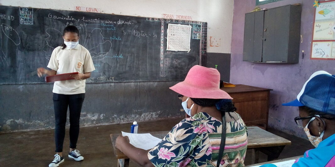 CARE Madagascar staff conducting a local disaster risk reduction committee involved in conducting Covid-19 response activities.