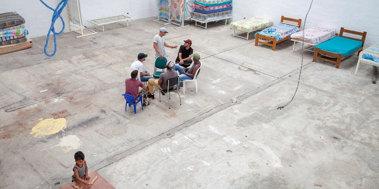 A group of Venezuelan migrants gather in a shelter in Quito, Ecuador