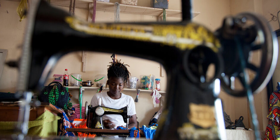 "Katraelle Johnson, 34 years old and mother of two children, had to retrain when Covid-19 arrived. Her grocery store was no longer receiving customers. Katraelle now makes children's clothing which she sells online. ""I wonder if we'll be able to go back to our old life,"" she worries. ""I don't know if I can get my shop back. It's total uncertainty and anxiety."" Porto Novo, Benin, 2020. Photo ©Laeïla Adjovi/CARE"