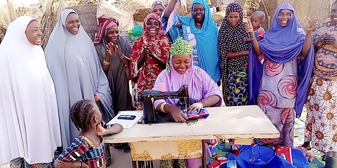 Lami with her savings group in Niger. © CARE Niger