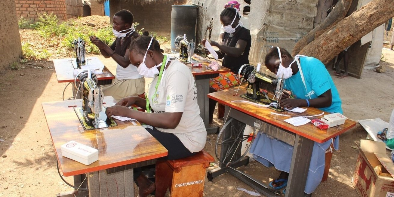 Members of the Gloden Star women's tailoring group in Uganda now producing masks for their community